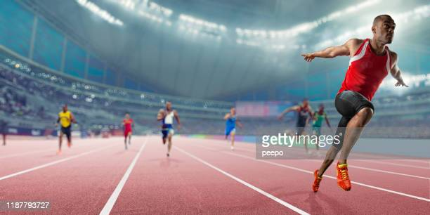 champion athlete wins sprint race competition in indoor track event - sports race stock pictures, royalty-free photos & images