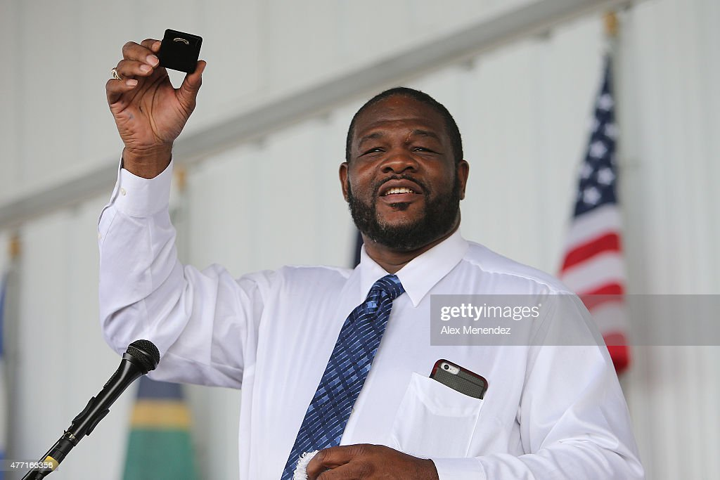Champion boxer Riddick Bowe holds up his hall of fame ring as he speaks during the induction ceremony at the International Boxing Hall of Fame induction Weekend of Champions events on June 14, 2015 in Canastota, New York.