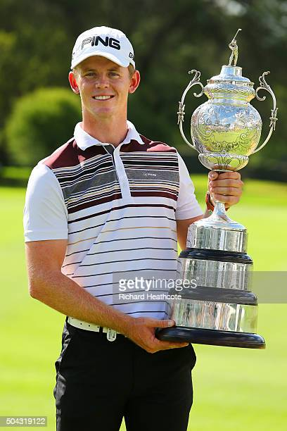 Champion Brandon Stone of South Africa poses with the South African Open trophy following his victory in the BMW SA Open at Glendower Golf Club on...
