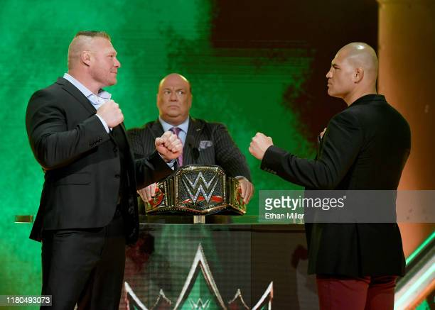 Champion Brock Lesnar and former UFC heavyweight champion Cain Velasquez face off as Lesnar's advocate Paul Heyman looks on during the announcement...