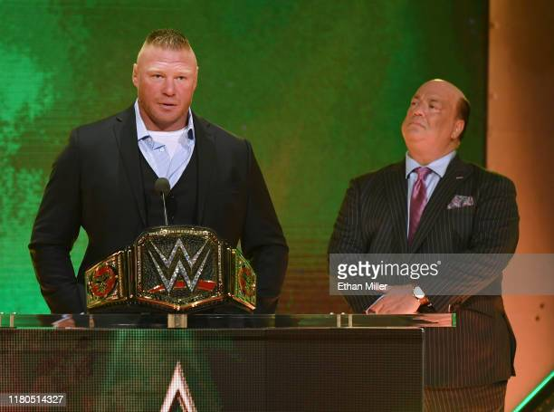 Champion Brock Lesnar speaks during a WWE news conference as his advocate Paul Heyman looks on at T-Mobile Arena on October 11, 2019 in Las Vegas,...