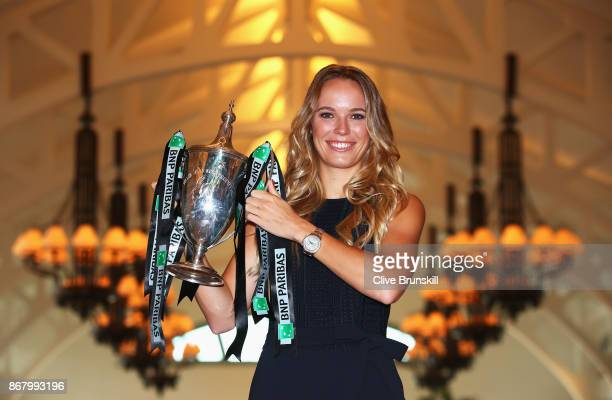 Champion Caroline Wozniacki of Denmark poses with the Billie Jean King trophy after her victory against Venus Williams of the United States in the...