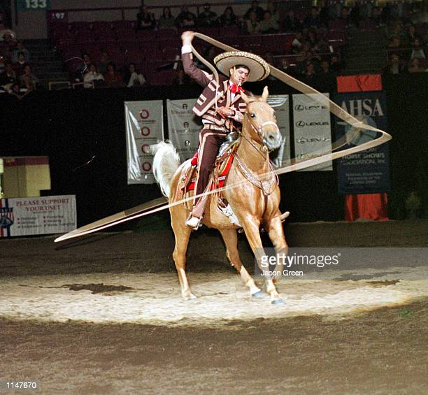 Champion Charro Gerardo 'Jerry' Diaz performs his own brand of equine magic at the National Horse Show held at Madison Square Garden November 58 1998...