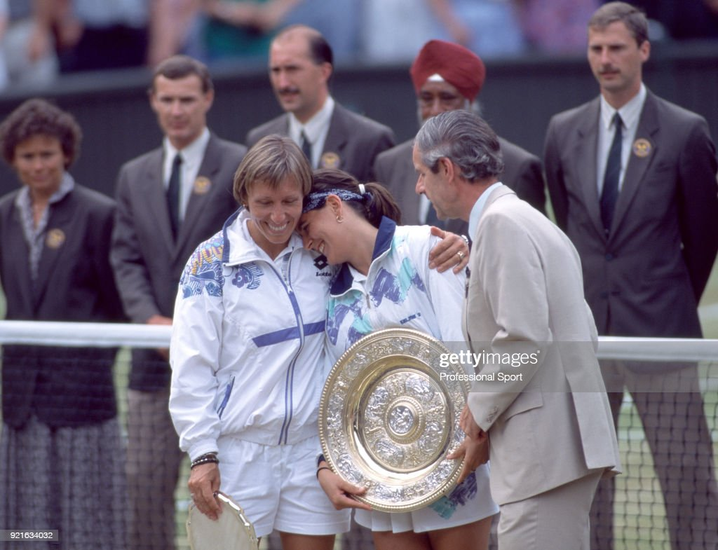 Champion Conchita Martinez of Spain (centre) and runner-up Martina Navratilova of the USA (left) on Centre Court with Chris Gorringe, the Chief Executive of the All England Club, following the Women's Singles Final of the Wimbledon Lawn Tennis Championships at the All England Lawn Tennis and Croquet Club, on July 2, 1994 in London, England.