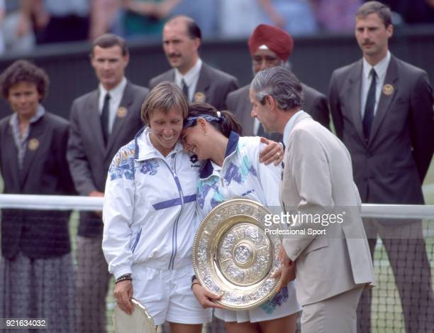 Champion Conchita Martinez of Spain and runnerup Martina Navratilova of the USA on Centre Court with Chris Gorringe the Chief Executive of the All...