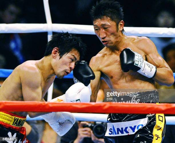 Champion Daisuke Naito of Japan and his compatriot Shingo Yamaguchi exchange blows during the WBC flyweight title match in Tokyo on December 23 2008...