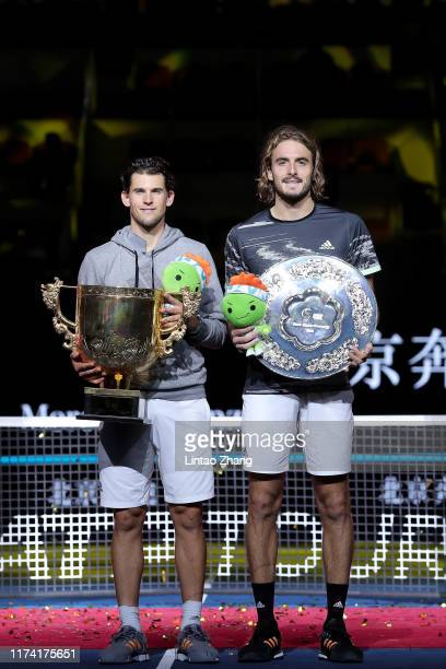 Champion Dominic Thiem of Austria and Stefanos Tsitsipas of Greece pose with their trophies after the Men's Singles final match on Day nine of 2019...
