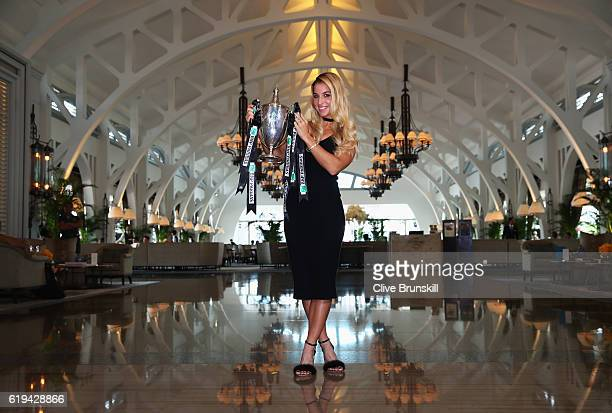 Champion Dominika Cibulkova of Slovakia poses with the Billie Jean King trophy after her victory against Angelique Kerber of Germany at Clifford Pier...
