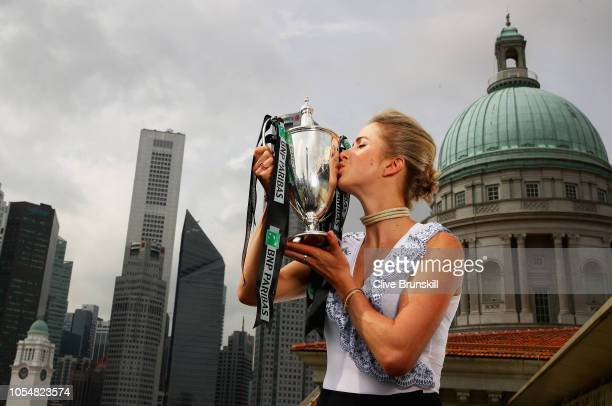 Champion Elina Svitolina of the Ukraine kisses the Billie Jean King trophy after her victory against Sloane Stephens of the United States in the...
