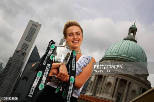 Champion Elina Svitolina of the Ukraine poses with the Billie Jean King trophy after her victory against Sloane Stephens of the United States in the...