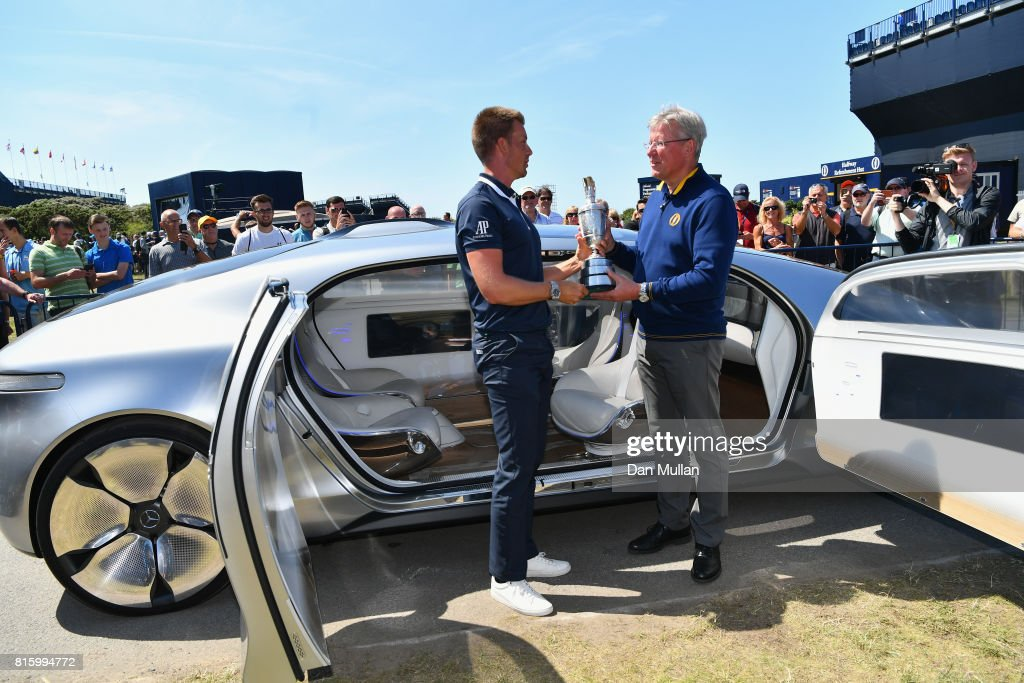 Champion Golfer of 2016 Henrik Stenson of Sweden returns the Claret Jug to R&A Chief Executive, Martin Slumbers during a practice round prior to the 146th Open Championship at Royal Birkdale on July 17, 2017 in Southport, England.