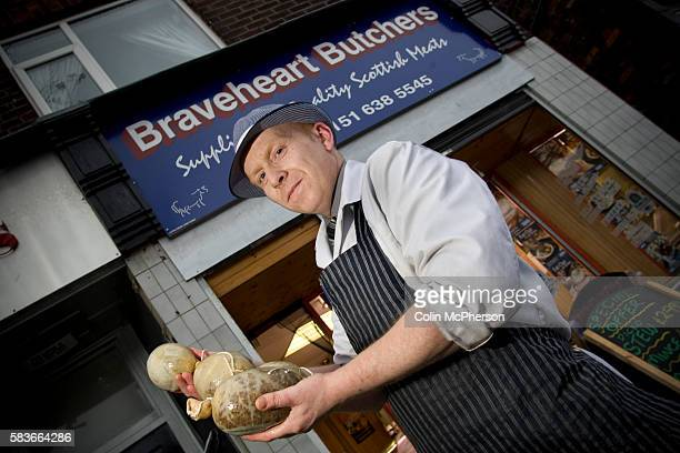 Champion haggis maker John Potter who relocated from his native Scotland to Merseyside with freshlymade haggis outside Braveheart Butchers which he...