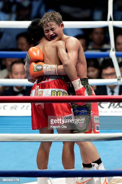Champion Hiroto Kyoguchi of Japan and challenger Vince Paras of the Philippines react after the IBF Minimumweight Title Bout at Ota City General...
