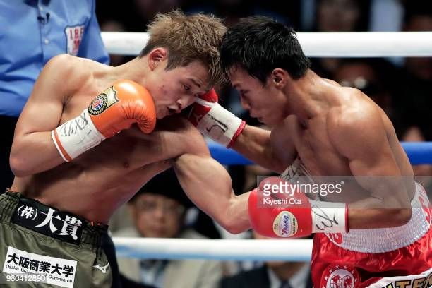 Champion Hiroto Kyoguchi of Japan and challenger Vince Paras of the Philippines in action during the IBF Minimumweight Title Bout at Ota City General...