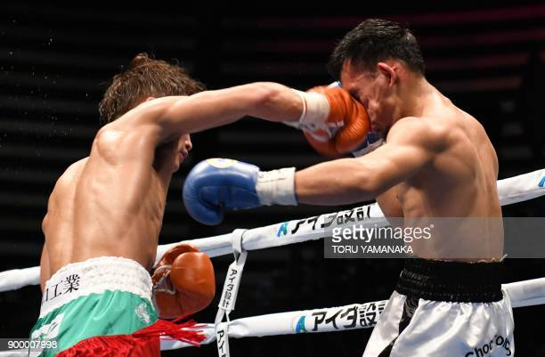 Champion Hiroto Kyoguchi of Japan connects with a punch against challenger Carlos Buitrago of Nicaragua in the seventh round of their IBF...
