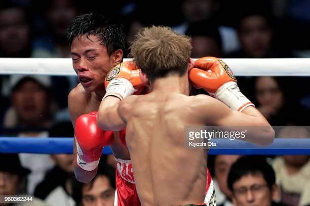 Champion Hiroto Kyoguchi of Japan punches challenger Vince Paras of the Philippines during the IBF Minimumweight Title Bout at Ota City General...