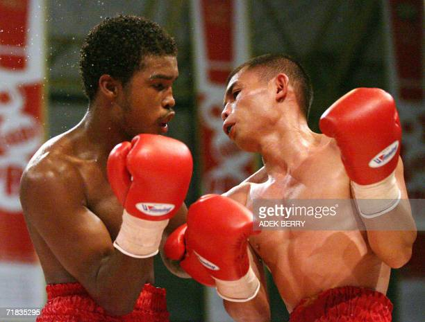 Champion in the featherweight division, Indonesian Chris John fights with Panamas Renan Acosta during their WBA featherweight champions fight in...