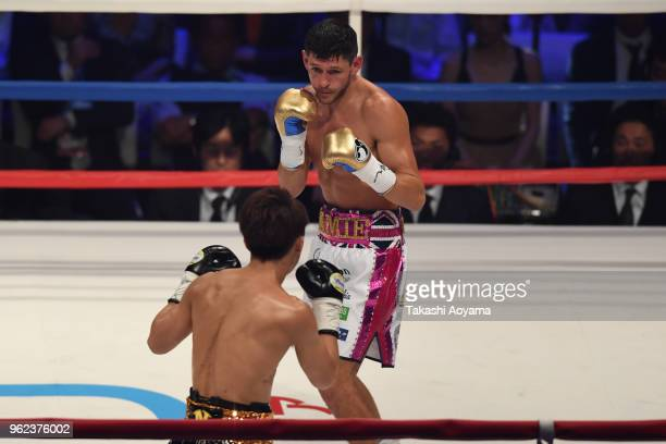 Champion Jamie McDonnell of Great Britain in action within Naoya Inoue of Japan during their WBA Bantamweight Title Bout at OtaCity General Gymnasium...