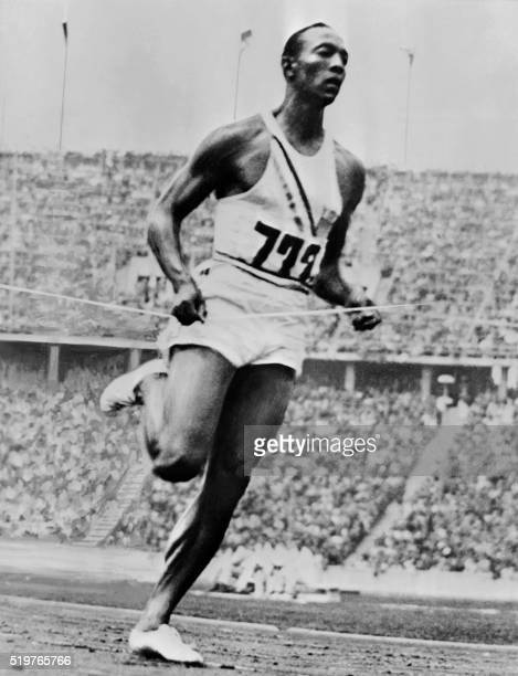 US champion 'Jesse' Owens crosses the finish line of the 200m event that he won on August 05 1936 during Olympic Games in Berlin where he captured 4...