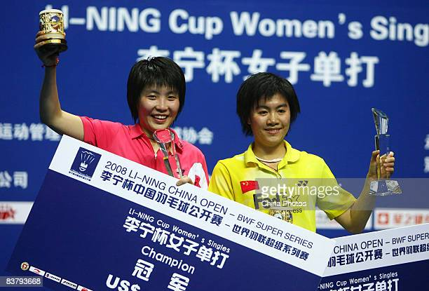 Champion Jiang Yanjiao of China and her compatriot, runner up Zhu Jingjing, pose with their trophies after the women's singles finals badminton match...