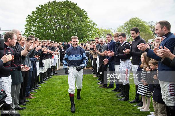 Champion jockey Richard Johnson is given a guard of honour from his fellow jockeys on April 23 2016 in Sandown England Sandhill Racing Stables set in...