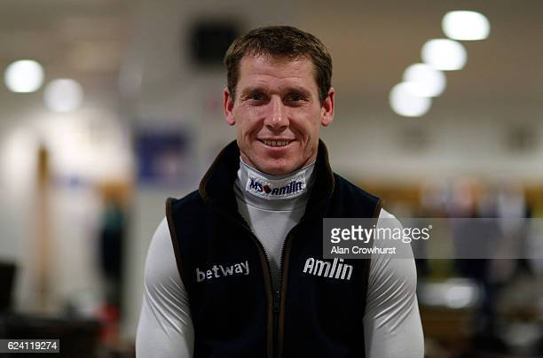 Champion jockey Richard Johnson poses in the changing room at Ascot Racecourse on November 18 2016 in Ascot England