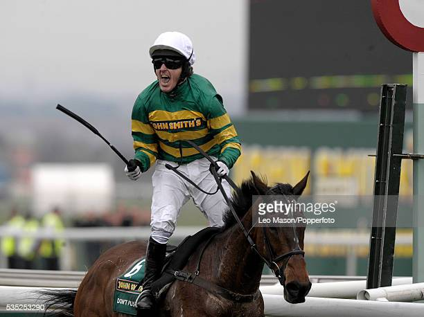 Champion jockey Tony McCoy rides Don't Push It to win the 2010 John Smith's Grand National Chase at Aintree racecourse near Liverpool on 10th April...