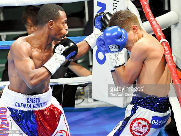 Champion Jonathan Guzman of Dominican Republic connects his left on challenger Yukinori Oguni of Japan in the 1st round during the IBF World Super...