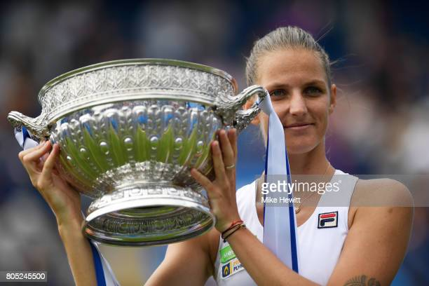 Champion Karolina Pliskova of the Czech Republic lifts the trophy following victory during the ladies singles final against Caroline Wozniacki of...