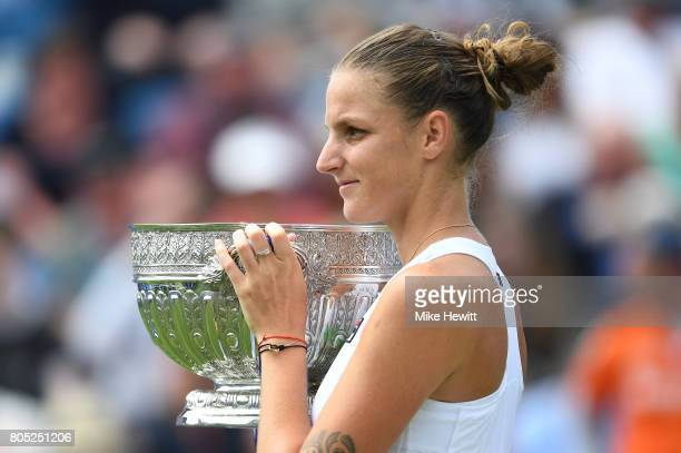 Champion Karolina Pliskova of the Czech Republic lifts the trophy following victory during the ladies singles final against Caroline Wozniacki of...