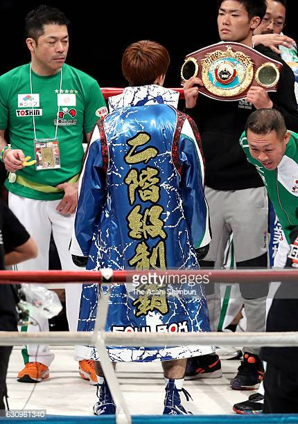 Champion Kosei Tanaka of Japan shows his new gown after beating Moises Fuentes of Mexico in the WBO Light Flyweight title bout at Gifu Memorial...