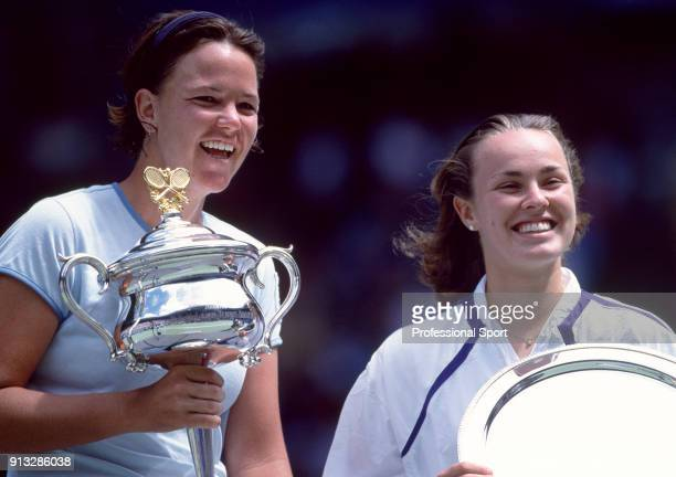 Champion Lindsay Davenport of the USA and runnerup Martina Hingis of Switzerland pose with their trophies after the Women's Singles Final of the...