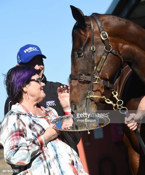 Champion mare Winx is seen posing with her 2017 Cox plate and part owner Debbie Kepitis at Flemington Racecourse on October 29 2017 in Melbourne...
