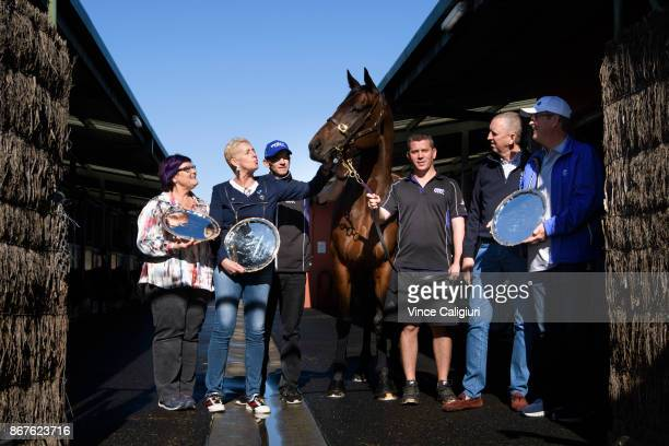 Champion mare Winx is seen posing with owners Debbie Kepitis Patricia Tighe track rider Ben Cadden strapper Umut Odemislioglu Peter Tighe and Paul...