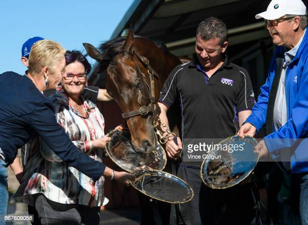 Champion mare Winx is seen posing with owners Patricia Tighe Debbie Kepitisstrapper Umut Odemislioglu and Paul Kepitis and her three Cox plates at...