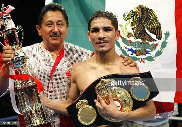Champion Martin Castillo of Mexico celebrates his victory over challenger Hideyasu Ishihara of Japan after the World Boxing Association Super...