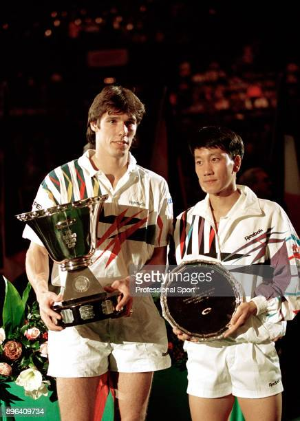 Champion Michael Stich of Germany and RunnerUp Michael Chang of the USA pose with their trophies after the Singles Final of the Compaq Grand Slam Cup...