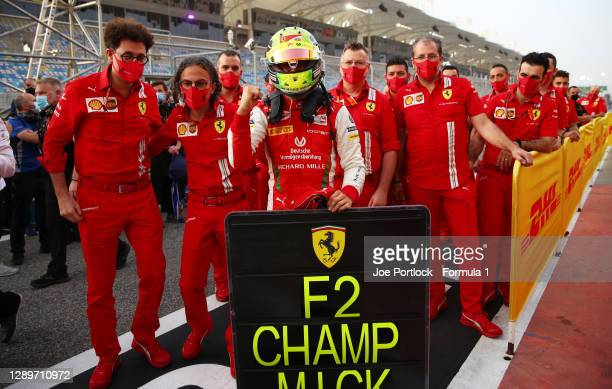 Champion Mick Schumacher of Germany and Prema Racing celebrates in parc ferme with Scuderia Ferrari Team Principal Mattia Binotto and Laurent Mekies,...