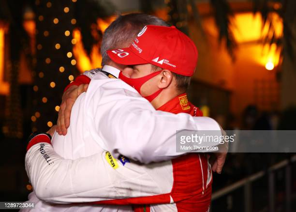 Champion Mick Schumacher of Germany and Prema Racing is congratulated by Ross Brawn, Managing Director of the Formula One Group, in the Paddock after...