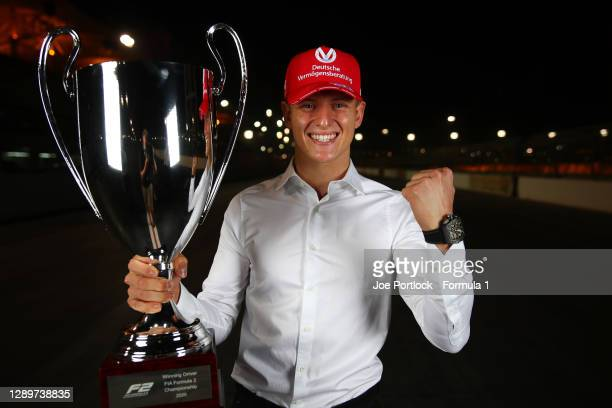 Champion Mick Schumacher of Germany and Prema Racing poses for a photo with his trophy during the Formula 2 Championship Prize Giving Ceremony at...