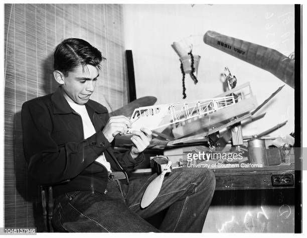Champion model airplane builder 19 October 1951 Donald Tune working with his model planeshas won 16 contests in a yearCaption slip reads 'Monday...
