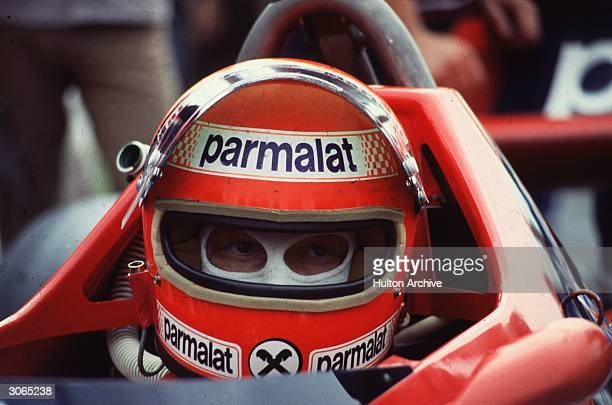 Champion motor racing driver Niki Lauda of the Parmalat racing team in his F1 Brabham Alfa Romeo during the British Grand Prix at the Brand's Hatch...