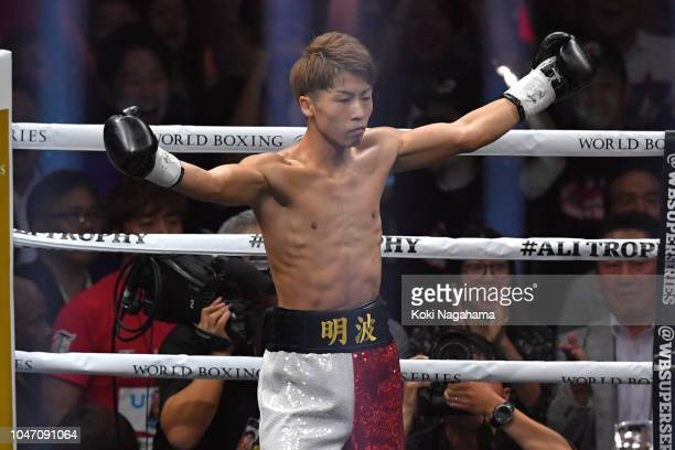 Champion Naoya Inoue of Japan celebrates defeating Challenger Juan Carlos Payano of the Dominican Republic in round one during the WBA bantamweight...