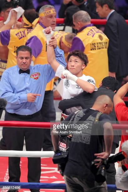 Champion Naoya Inoue of Japan celebrates his knock out victory over challenger Ricardo Rodriguez of Mexico in the third round during the WBO Super...