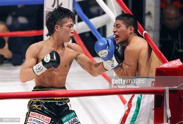 Champion Naoya Inoue of Japan connects his left on challenger David Carmona of Mexico during their WBO Super Flyweight Title Bout at the Ariake...