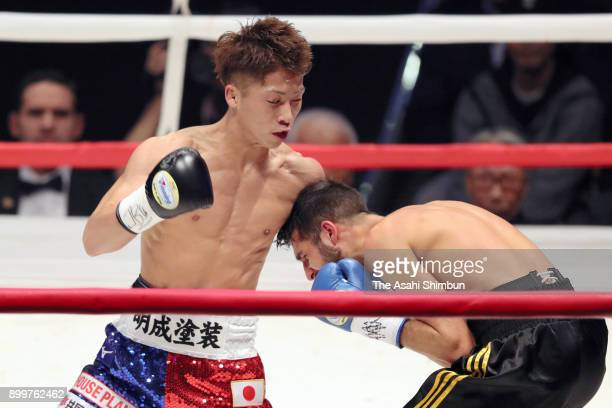 Champion Naoya Inoue of Japan connects his left on challenger Yoan Boyeaux of France in the third round during their WBO Super Flyweight Title Bout...