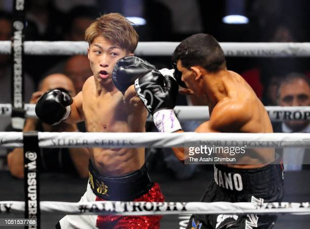 Champion Naoya Inoue of Japan connects on Challenger Juan Carlos Payano of the Dominican Republic in the 1st round during the WBA bantamweight title...