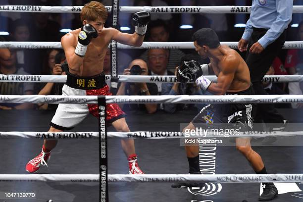 Champion Naoya Inoue of Japan in action against challenger Juan Carlos Payano of the Dominican Republic during the WBA bantamweight title bout as a...
