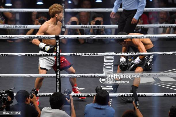 Champion Naoya Inoue of Japan knocks down challenger Juan Carlos Payano of the Dominican Republic during the WBA bantamweight title bout as a part of...