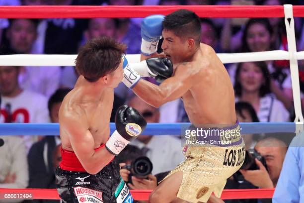 Champion Naoya Inoue of Japan knocks out challenger Ricardo Rodriguez of Mexico in the third round during the WBO Super Flyweight title bout at...